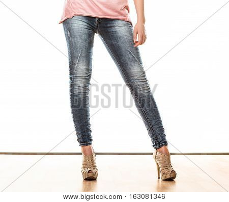 Fashion and people concept. Woman legs in denim trousers platform high heels shoes casual style isolated on white background