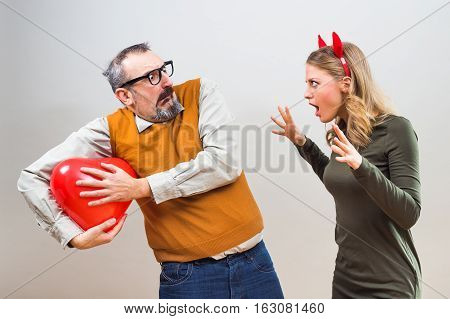 Nerdy man is afraid that this girl will broke his heart.
