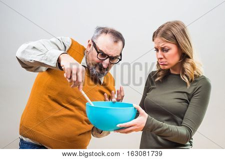 Nerdy man would like that his wife spend more time in the kitchen,but she doesn't want to.