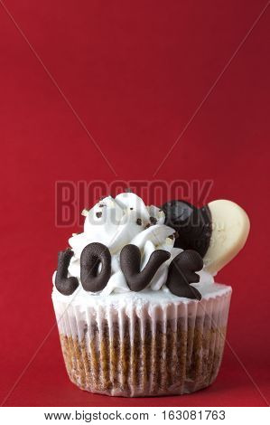 Valentine cupcakes on red,  close up photo