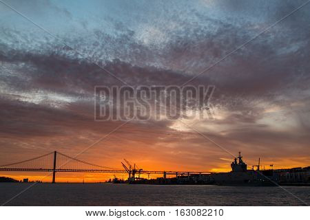 Panoramic views of the Tagus River, Bridge April 25 Lisbon and Lisbon port sunset from ship, Portugal.