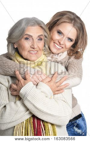 close up portrait of mother and her adult daughter