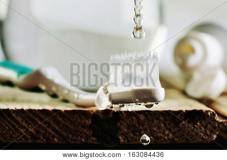 Wet Toothbrush On The Wooden Table. Water Drops Dripping On The This Toothbrush. Horizontal