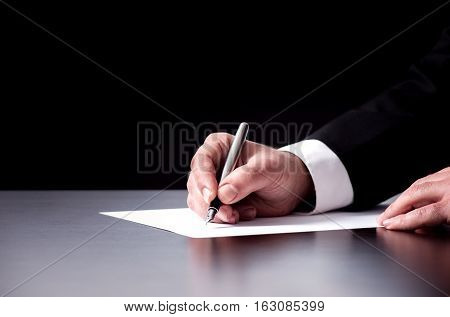 Businessman Writing Or Signing An Official Document