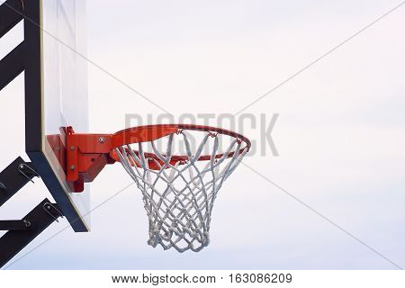 Sport. Open air. Basket with net. Clean sky on the background.