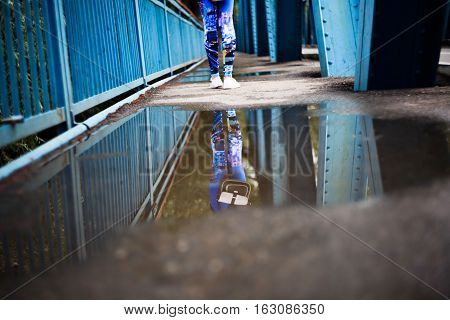 beautiful reflection in a puddle on the bridge