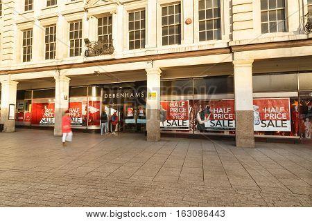 NOTTINGHAM ENGLAND - DECEMBER 26: Customers enter Debenhams as Boxing Day sales get under way. In Nottingham England. On 26th December 2016.
