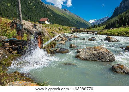 A small hydroelectric dam on a wild river Arashan Kyrgyzstan.