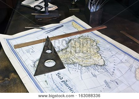 Old sea chart and tools of the seaman