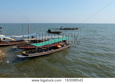 Fishing boats of fishermen in the sea in Thailand.