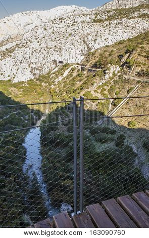 Gorge of the Gaitanes and Caminito del Rey path Malaga Spain. River and railway from the wooden footpath