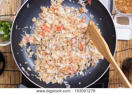 Chef cooking rice in pan / cooking fired rice concept