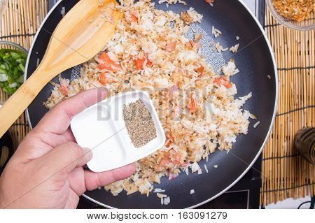 Chef putting peoper for cooking fried rice / cooking fired rice concept