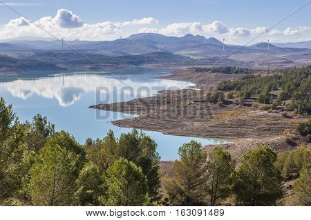 El Chorro reservoir landscape with windmills at bottom close to Gorge of the Gaitanes Malaga Spain