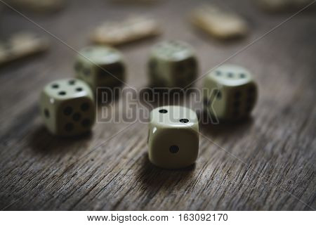 dice closeup on a wooden table, game abstract