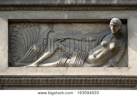 Bas-relief as architectural detail on the wall of an apartment house in Lviv Ukraine