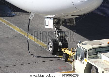 Fore carriage of a modern airplane on asphalt in an airport