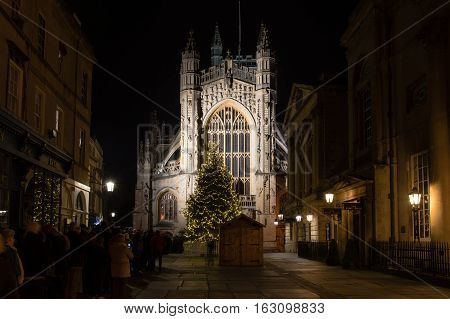 BATH UK - December 24 2016 People queue for Christmas Midnight Mass at Bath Abbey. Hundreds line up ahead of religious service to celebrate Christmas at Anglican Cathedral