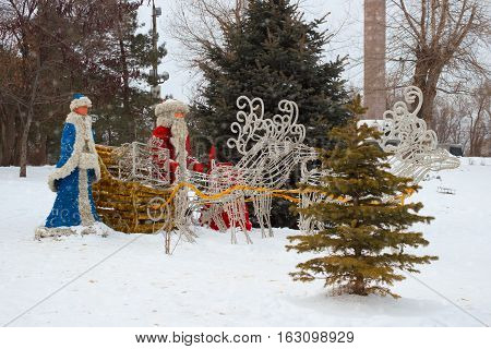 VOLGOGRAD RUSSIA - December 15 2016: A sculpture of Father Frost (Santa Claus) and Snow Maiden in the winter in the park on the city street Volgograd