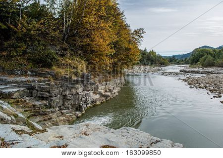 Carpathian Mountains in Ukraine. Mountain River. Autumn day in the mountains.