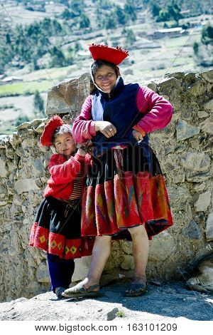 Portrait of a Quechua Indian woman and her daughter from the Patachancha Community Andes Mountain. October 21 - 2012 Cuzco Region Peru