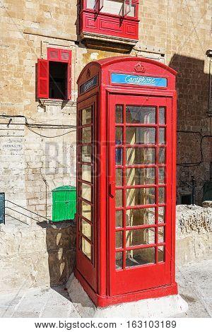 Vintage call box in malta city view