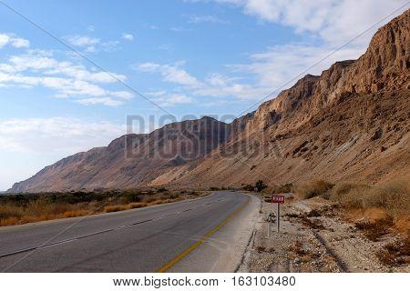 Empty highway leading to Dead Sea in Judea Desert Israel.