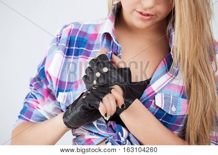A young girl wears gloves for dancing.
