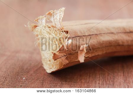 Dry Luffa on the wooden, old tone