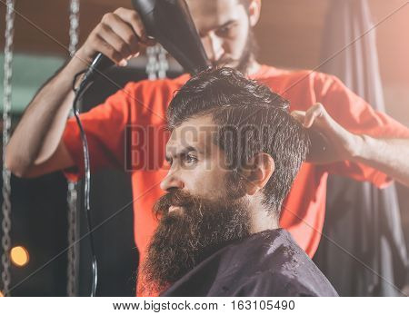 Barber Drying Hair To Man