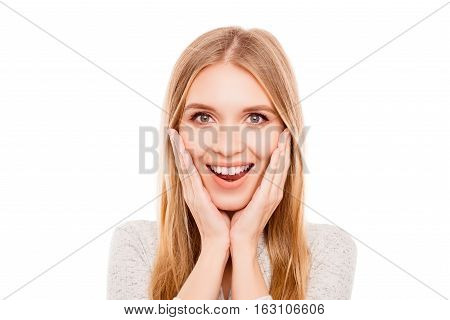 Surprised Pretty Young Woman Holding Hands Near Face