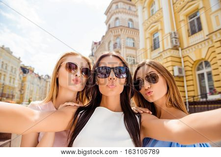 Three Pretty  Girlfriends In Glasses Making Selfie And Pouting While Walk  City