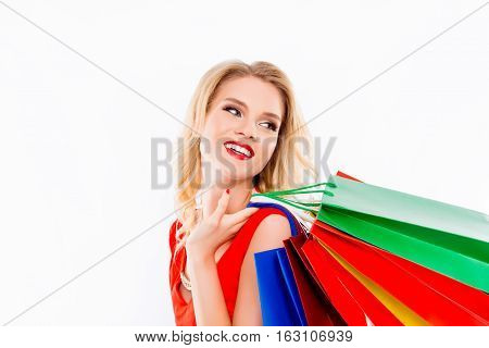 Portrait Of Pretty Smilling Shopper Holding Bags After Successful Shopping