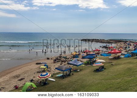 People On Early Morning Beach At Scottburgh In  South Africa