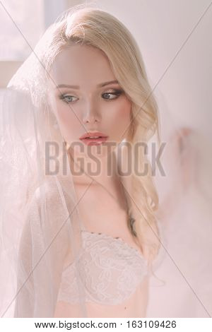 Beautiful Sexy Lady In Elegant White Lingerie Wearing Wedding Veil. Portrait Of Fashion Model Girl I
