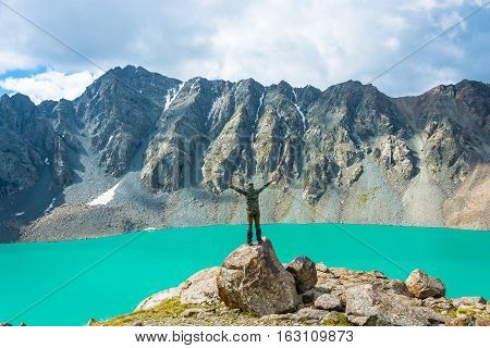 A Man On A Huge Rock Performs The Asanas.
