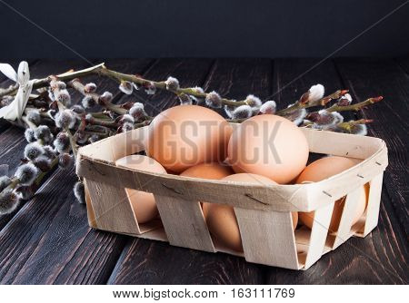 Chicken eggs in basket on wood desk. Nature background