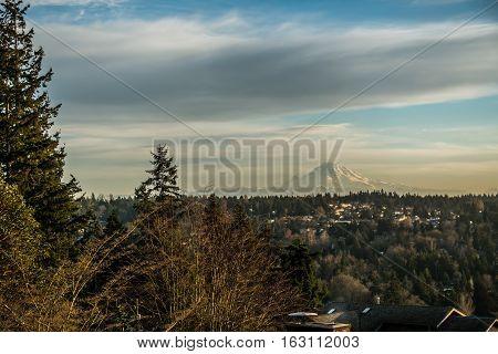 Mount Rainier can be see across homes in Burien Washington.