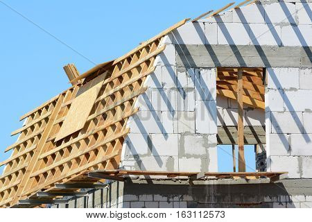 Attic construction. Reconstruction of the wooden roof.