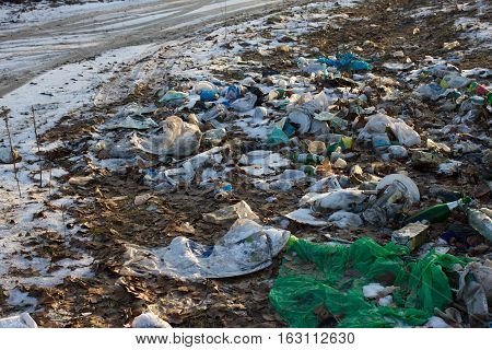 Pile of plastic bags and other refined petroleum products dumped in landfill. Garbage heap gives infiltrate into groundwater. Waste sorting is required. Lviv city
