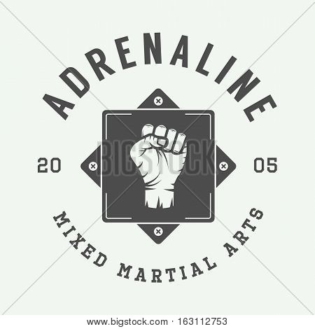 Vintage mixed martial arts logo badge or emblem. Vector illustration. Graphic art.