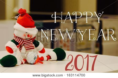 Office cute snowman on cubicle with words Happy New Year 2017 for greeting social network image,poster,postcard, greeting card for wishing community happy new year with room for copy or logo