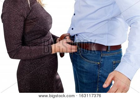 Picture of a woman having sexual gesture opening a man's belt
