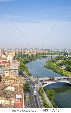 Aerial view of the river Ebro, bridges and Zaragoza city from the tower of Cathedral-Basilica of Our Lady of the Pillar in summer, Zaragoza, province Aragon, Spain