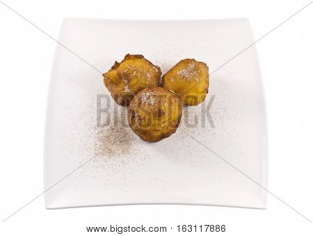 Filhoses de Abobora or pumpkin fritters are small yellow pumpkin fried cakes tradionally made during the Christmas season in Portugal