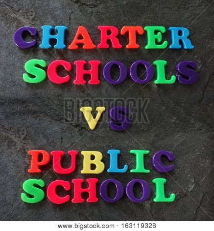 Charter Schools vs Public School spelled out in play letters -- education concept