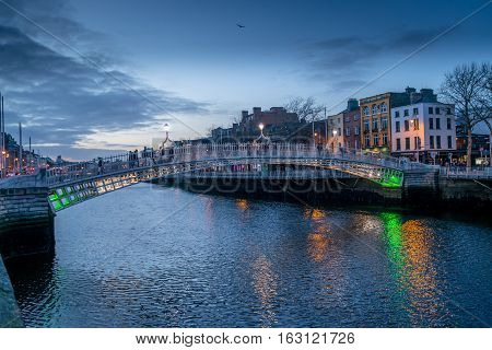 Dublin, Ireland - 26 Dec 2016: Evening view of famous Ha'penny Bridge in Dublin, Ireland at sunset