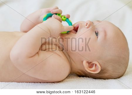 painful teething in infants baby close-up with a toy