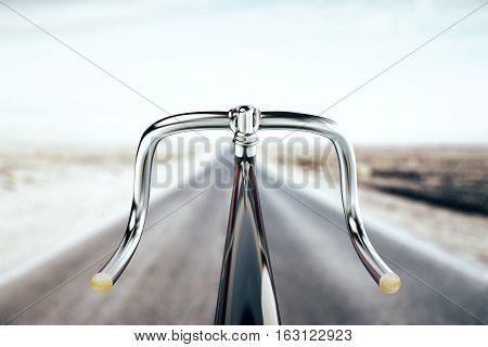 Close up of black bike handlebar on road backgrpound. Travel concept. 3D Rendering