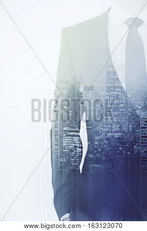 Man in suit on city background. Double exposure. Employment concept